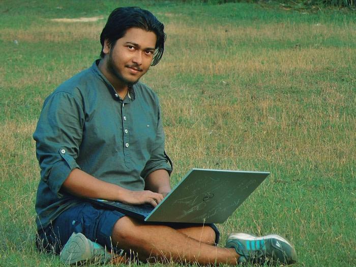 Man working on laptop at playground